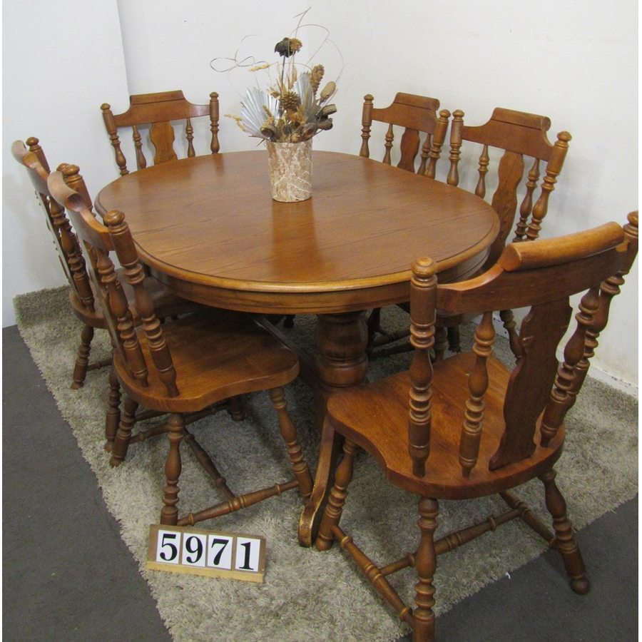 A5971  Solid extending table with 6 chairs.